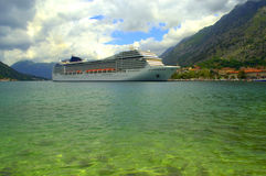 Cruise ship in emerald water Royalty Free Stock Image