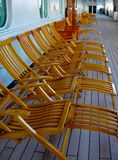 Empty Deck Chairs on Cruise Ship. Early morning on the cruise ship finds the poop-deck chairs ready for passengers Royalty Free Stock Photos