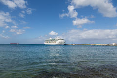 Cruise Ship at End of Pier in Calm Bay. White Luxury Cruise Ship Docked at St Croix Stock Photography