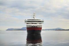 Cruise Ship entering a Norwegian fjord. Scandinavia royalty free stock photo