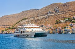 Cruise ship enters the port of the island of Sym Royalty Free Stock Photography