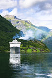 Cruise ship in fjord. Near Geiranger Royalty Free Stock Photography