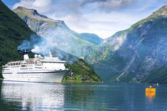 Cruise ship. In fjord near Geiranger Stock Images