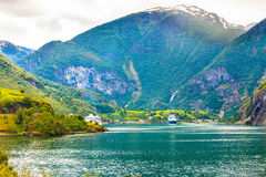 Cruise ship on fjord Sognefjord in Flam Norway. Tourism vacation and travel. Mountains landscape and big cruise ship on fjord Sognefjord in Flam Norway Royalty Free Stock Photos