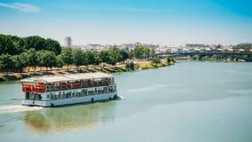 Cruise ship floating in Guadalquivir river in. Seville, Spain royalty free stock image