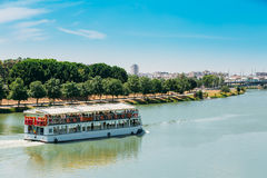 Cruise Ship Floating In Guadalquivir River In Seville, Spain.  royalty free stock photo