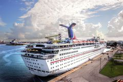 Cruise Ship at Freeport, Bahamas, against Clouds and Sky. A cruise ship is tied up at the dock at Freeport, Bahamas, while passengers disembark to do some royalty free stock photography