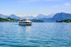 Cruise ship in front of Alps mountains peaks on Lake Lucerne, Sw Royalty Free Stock Photos