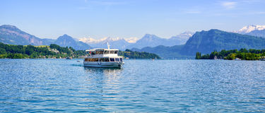 Cruise ship in front of Alps mountains peaks on Lake Lucerne, Sw Stock Photos