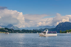 Cruise ship in front of snow covered Alps mountains peaks on Lak Stock Photography