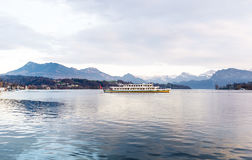 Cruise ship in front of snow covered Alps mountains peaks on Lake Lucerne Stock Images