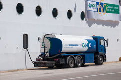 Cruise ship fueling. Gasoline Truck fuelling cruise ship MSC Armonia, in Piraeus, Greece Stock Images