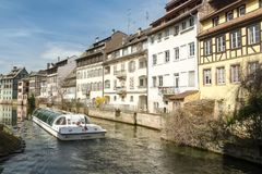 Cruise ship full of tourists in pictoresque Little France distri. STRASBOURG, FRANCE - APRIL 03, 2018: Cruise ship full of tourists in pictoresque Little France Stock Images