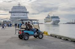 Two Cruise Ship in Galveston Harbour. One is leaving Two men watching stock photo