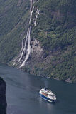 Cruise ship in Geiranger Fjord Stock Photos
