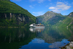 Cruise Ship Geiranger Fjord - Horizontal. The Geiranger fjord is one of Norway's most visited tourist sites and has been listed as a UNESCO World Heritage Site Stock Photography