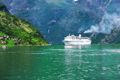 Cruise ship at Geiranger Fjord Royalty Free Stock Photos