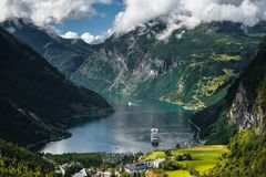 Cruise ship in Geiranger fjord, Norway royalty free stock photography