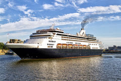 Cruise ship. Getting under way stock images
