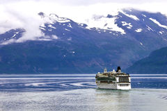 Cruise ship in Glacier Bay. Lone cruise ship sails into Glacier Bay in Alaska Royalty Free Stock Photography