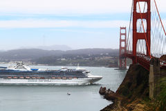 Cruise Ship Golden Gate Bridge. Cruise ship passing Golden Gate bridge, Concept for travel or vacation Royalty Free Stock Image