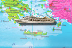 Cruise ship Greece. Cruise ship travel on colorful political map of Europe to Athens, Crete and Islands of Greece. Geopolitical school atlas. Holidays and travel royalty free stock photography