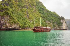 Cruise ship at Ha Long Bay Vietnam Asia. Cruise ship at Ha Long Bay in Vietnam, Asia. Limestone islands on the background stock image