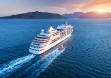 Aerial view of beautiful large white ship at sunset. Cruise ship at harbor. Aerial view of beautiful large white ship at sunset. Colorful landscape with boats in Royalty Free Stock Photo