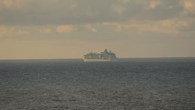 Cruise ship on the horizon stock video footage