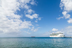 Cruise Ship on Horizon Under Nice Skies. White Luxury Cruise Ship Docked at St Croix Stock Photos