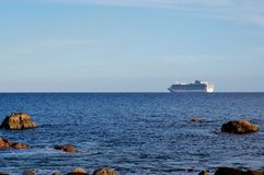 Cruise ship on the horizon Royalty Free Stock Images