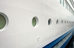 Cruise ship hull. Perspective view of cruise ship hull with many portholes royalty free stock image