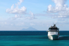 Cruise Ship with Island in Background Stock Photo