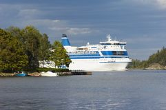 Cruise-ship between islands Stock Images