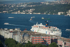 Cruise ship in Istanbul harbour, Turkey. White cruise ship at the Turkish coast. Summer 2013 in Istanbul-Turkey Royalty Free Stock Images