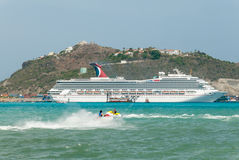 A cruise ship and jet skis on Divi Bay II Stock Photo