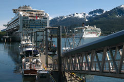Cruise Ship In Juneau, Alaska. Cruise ship docked in Juneau, Alaska harbor Stock Photos