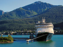 Cruise ship in Juneau, Alaska harbor. Cruise ship moored at a dock in the harbor in Juneau, Alaska stock image