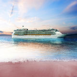 Cruise ship just off the coast of an island Stock Photography