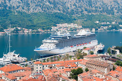 Cruise ship in Kotor. Aerial view of Bay of Kotor, Montenegro. White luxury cruise ship and yachts in harbor stock photo