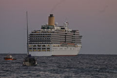 Cruise ship leaves the port late in the evening.  stock photos