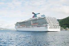 Cruise Ship Leaving. A Cruise Ship heading out to sea royalty free stock photos