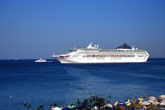 Cruise ship leaving the Deepwater Harbour on the island of Rhodes royalty free stock images