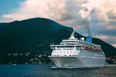 Cruise ship leaving from Kotor bay Boka Kotorska, Montenegro. Beautiful mediterranean adriatic landscape.  stock image