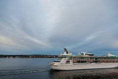 Cruise Ship Leaving Port at Dusk Royalty Free Stock Photos