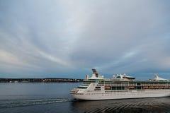 Cruise Ship Leaving Port at Dusk Royalty Free Stock Photos