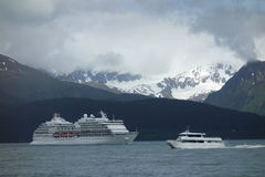 A cruise ship leaving the port at seward Stock Photos