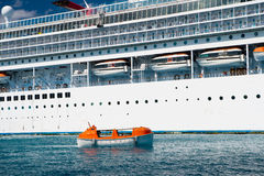 Cruise ship with life boat Stock Images