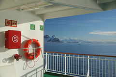 Cruise ship, life preserver. In calm seas, blue sky, with mountains & glaciers, Lemaire Channel,Antarctica Stock Photos