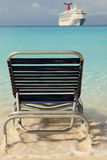Cruise ship and lounge chair in blue ocean Stock Images